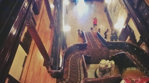 Looking down the grand staircase to the mansion's foyer.